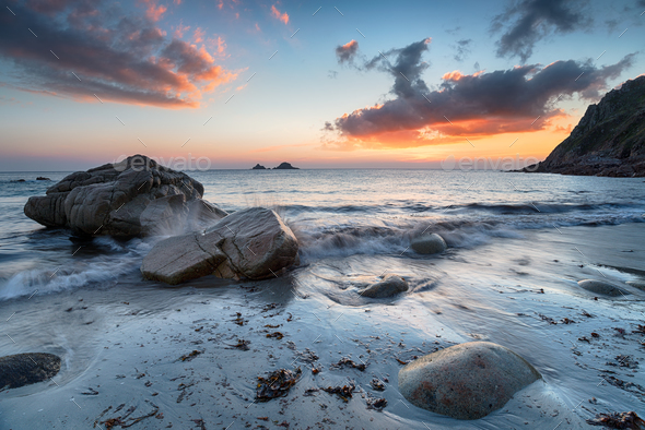 Sunset at Porth nanven in Cornwall - Stock Photo - Images