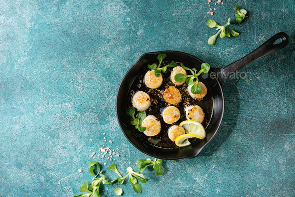 Fried scallops with butter sauce - Stock Photo - Images