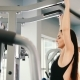 Attractive Young Woman Exercising in Gym - Training for Shoulders - VideoHive Item for Sale