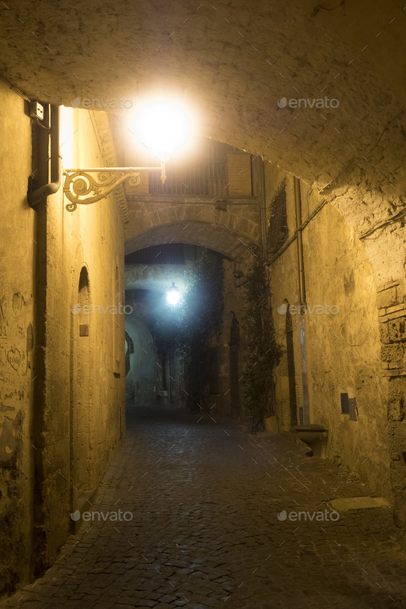 Orvieto (Umbria, Italy), old street by night - Stock Photo - Images