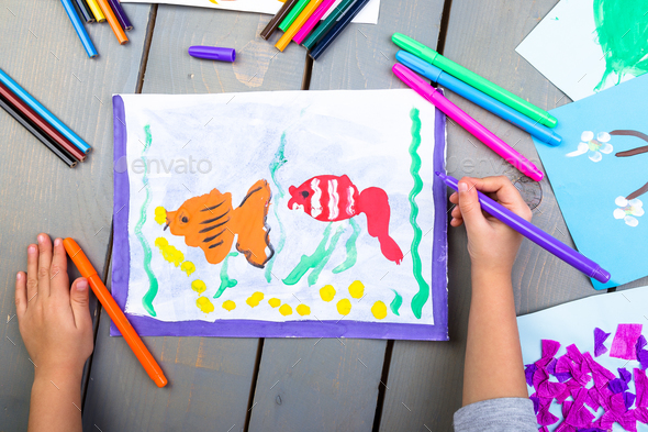Top view of child hands with pencil painting picture - Stock Photo - Images