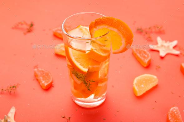 Orange fruit cocktail, detox water on orange background. - Stock Photo - Images