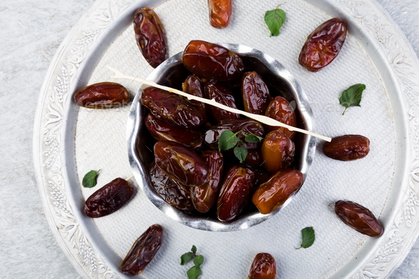 Dry fruit dates on silver tray. Copy space. - Stock Photo - Images