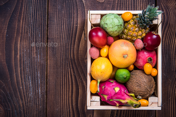 Wooden box with exotic fruits - Stock Photo - Images