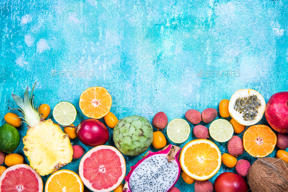 Mixed fresh vibrant exotic fruits, border background - Stock Photo - Images