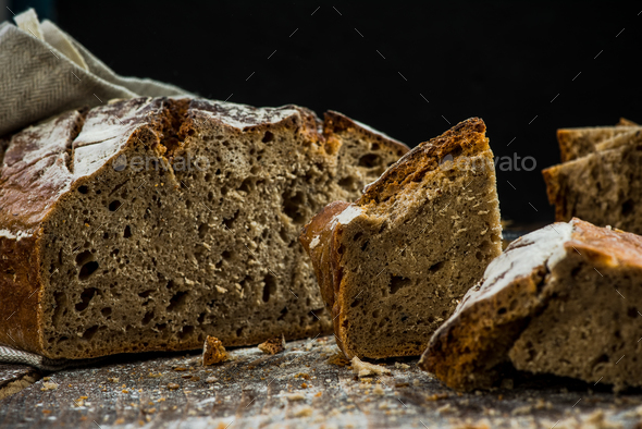 Healthy wholegrain traditional bread for sharing - Stock Photo - Images