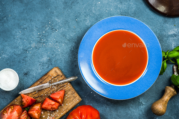 Serving fresh homemade tomato soup - Stock Photo - Images
