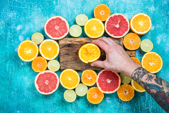 Hand squeezing orange for juice - Stock Photo - Images