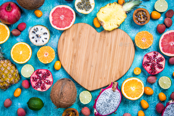 Wooden heart shape copy space with exotic fruits - Stock Photo - Images