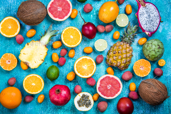 Exotic fruits on vibrant concrete slate,flat lay - Stock Photo - Images