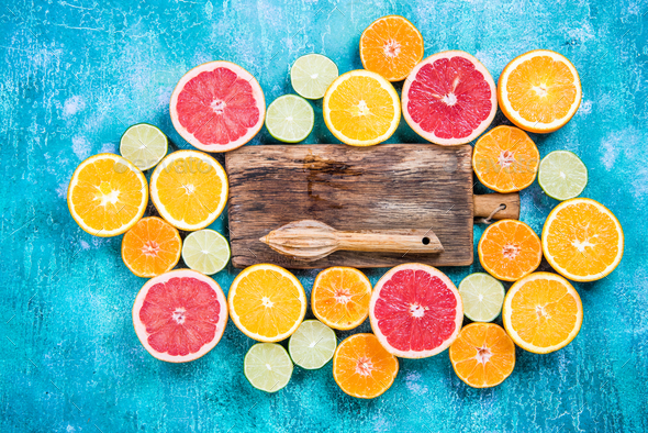 Halves of citrus fruits overhead, healthy eating - Stock Photo - Images