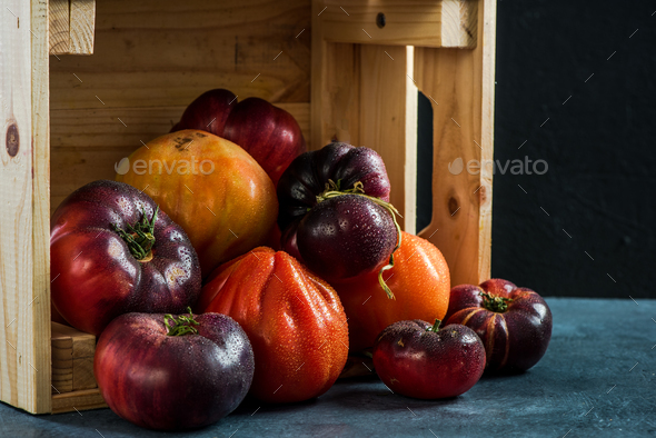 Ripe fresh tomatoes in wooden harvest box - Stock Photo - Images