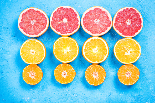 Citrus fruits halves flat lay - Stock Photo - Images