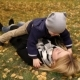 Mother and Son Lie on Yellow Leaves in Autumn Park - VideoHive Item for Sale