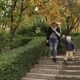 Mom and Son Go Down the Stairs in Park in Fall - VideoHive Item for Sale