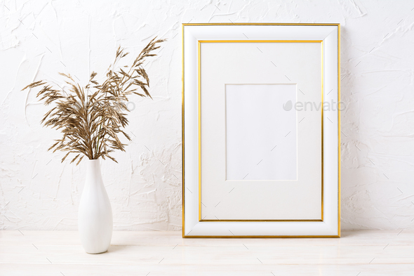 Gold decorated frame mockup with dried grass - Stock Photo - Images