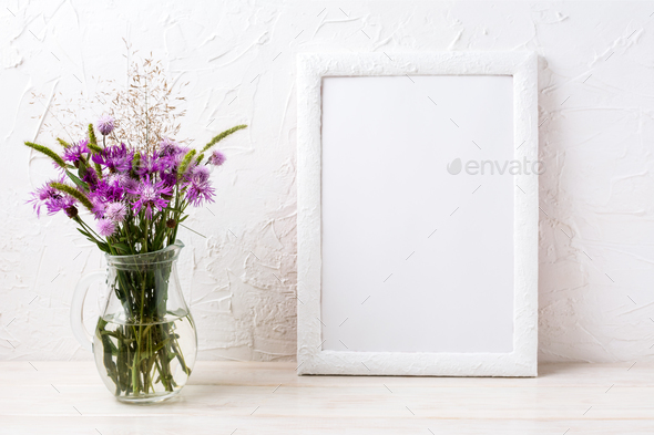 White frame mockup with burdock flowers in the jug - Stock Photo - Images