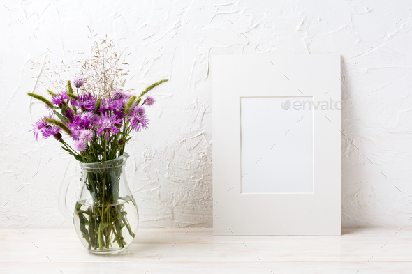 White frame mockup with purple burdock in the glass jug - Stock Photo - Images