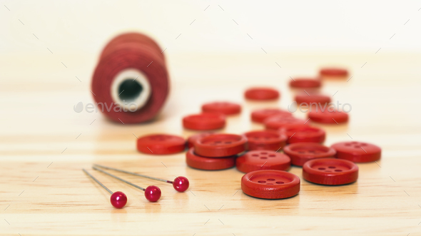 Red sewing supplies close-up - Stock Photo - Images