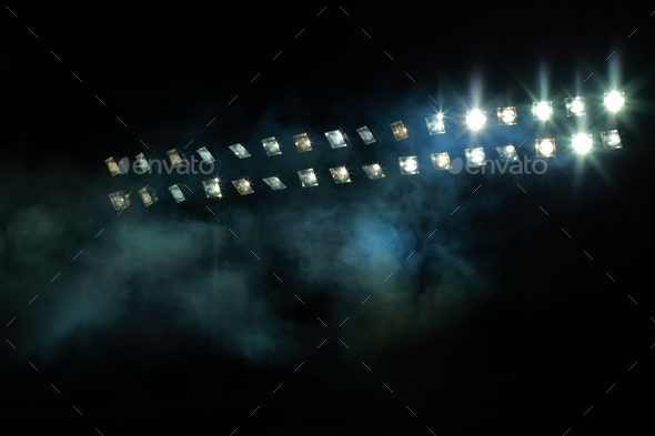 Stadium lights against dark night sky - Stock Photo - Images