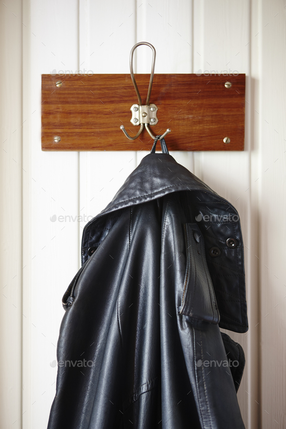Classic male black leather jacket stored on a hanger. Vertical - Stock Photo - Images