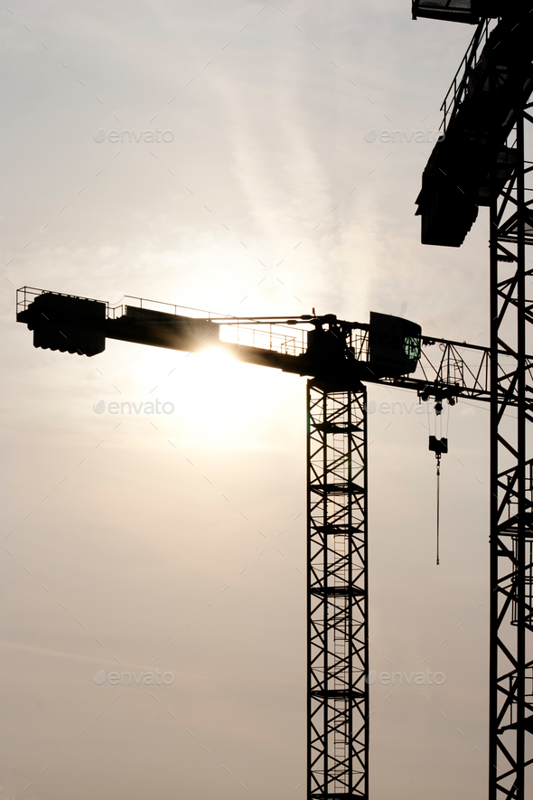 Construction crane at the back light - Stock Photo - Images
