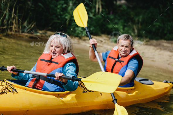 Elderly marriage rowing in the kayak - Stock Photo - Images