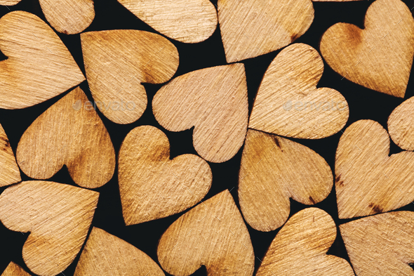 Wooden hearts laying together tightly - Stock Photo - Images
