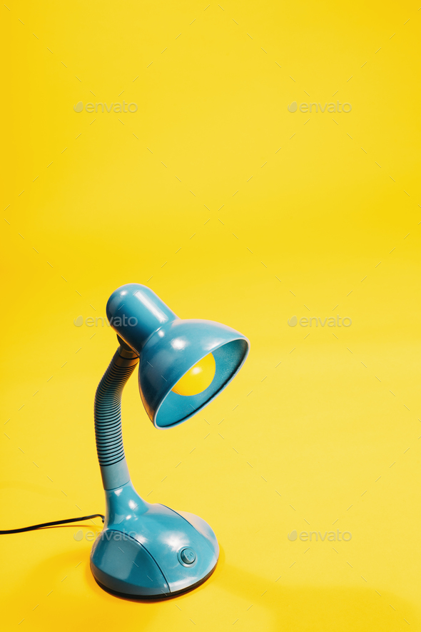 Sky-blue desk lamp on yellow background. - Stock Photo - Images