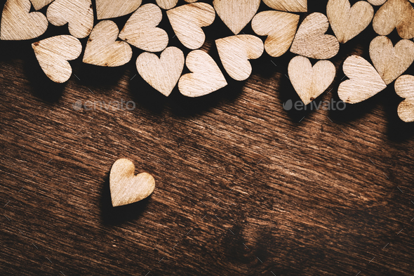Wooden hearts on dark wooden background - Stock Photo - Images