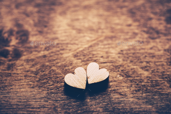 Two hearts on a wooden background - Stock Photo - Images