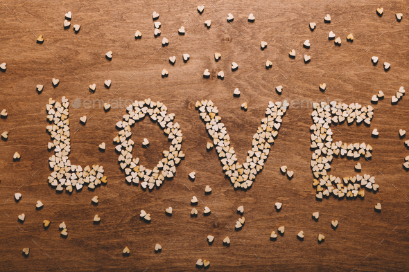 """Love"" writing made from little hearts. - Stock Photo - Images"