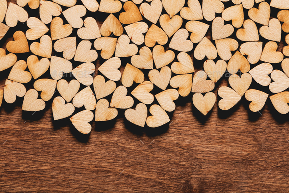 Little hearts on wooden background. - Stock Photo - Images