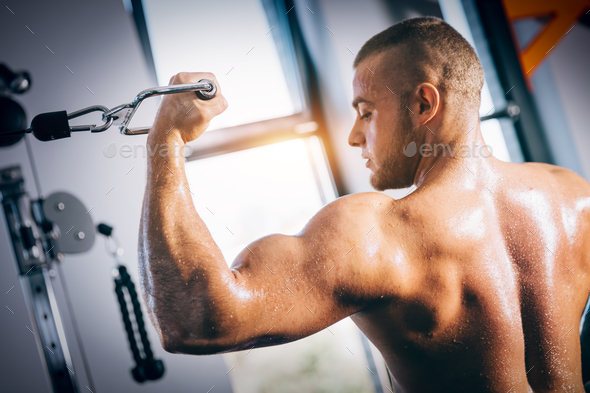 Muscular man showing off his muscles. - Stock Photo - Images