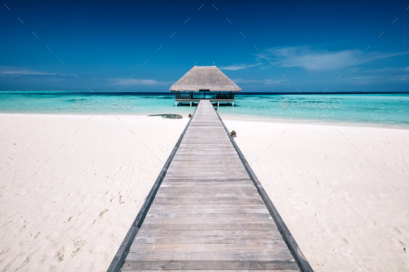 Wooden jetty leading to a terrace on water. - Stock Photo - Images