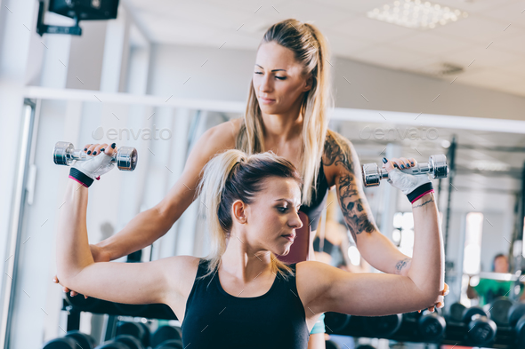Woman insuring other woman in her training. - Stock Photo - Images