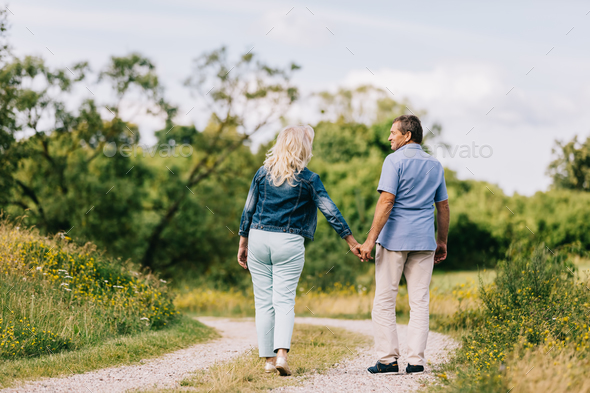 Senior couple having a walk. - Stock Photo - Images