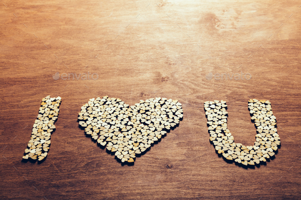 """I love you"" symbol made from wooden hearts. - Stock Photo - Images"