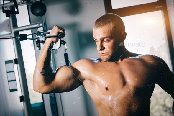Strong man tightening his muscles - Stock Photo - Images