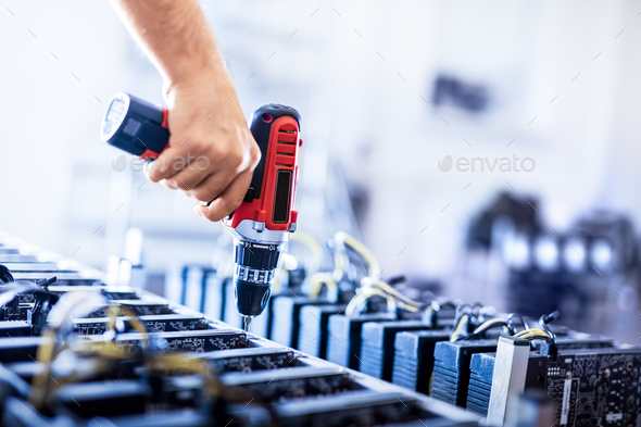 Assembling bitcoin mining machines. Cryptocurrency farm - Stock Photo - Images