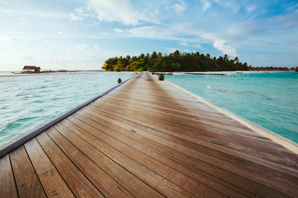 Jetty on sea leading to an island. - Stock Photo - Images