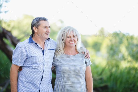 Old marriage embracing each other - Stock Photo - Images