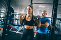 Man instructing a woman on a gym. - PhotoDune Item for Sale