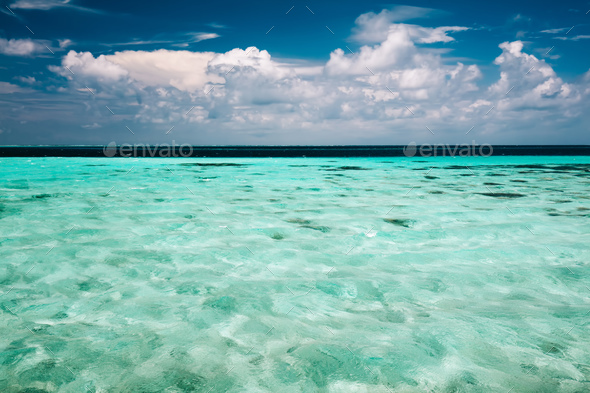 Clear ocean water and a cloudy blue sky - Stock Photo - Images
