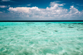 Clear ocean water and a cloudy blue sky - PhotoDune Item for Sale