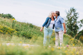 Old couple kissing on a walk. - PhotoDune Item for Sale