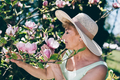 Senior woman smelling flowers on a tree - PhotoDune Item for Sale