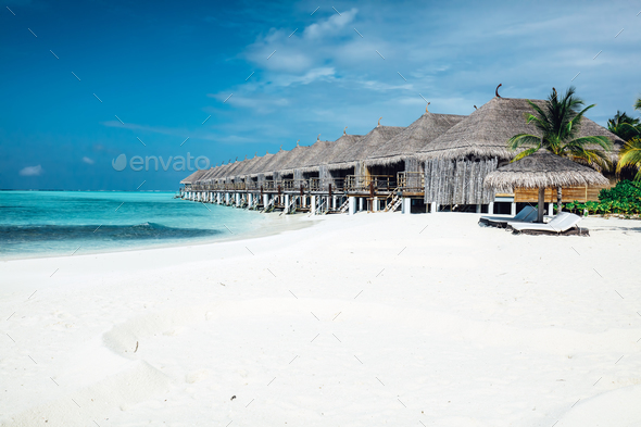 Summer wooden water villas on Maldives - Stock Photo - Images