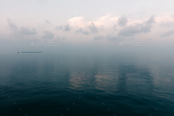 Blue ocean water and cloudy sky - Stock Photo - Images