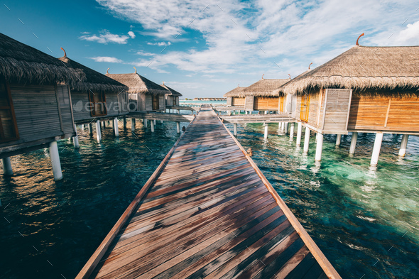 Jetty leading to water villas. Maldives - Stock Photo - Images